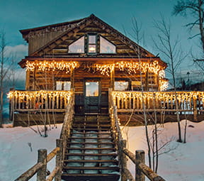 Lynn Britt Cabin in Snowmass, Colorado at night.