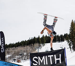 Snowboarder doing a trick at the Smith Grudge Match event in Aspen Colorado.