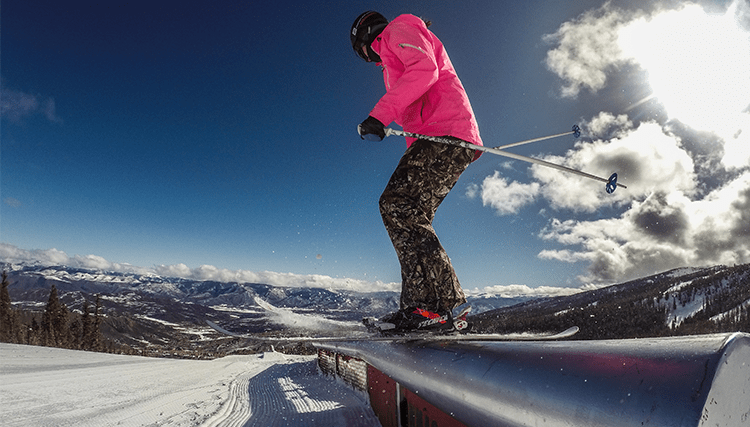 Aspen Skier Riding a Rail