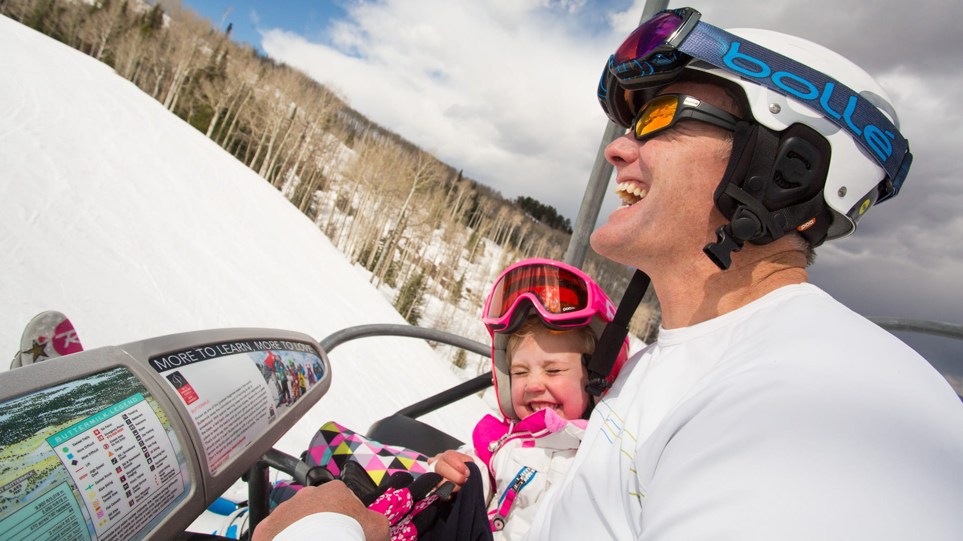 Happy Skiers on Chairlift in Aspen